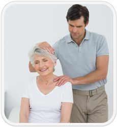 chiropractor treating older patient